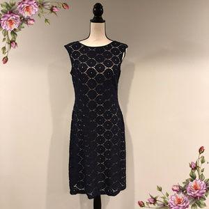 Dark navy blue lace with cream lining dress.